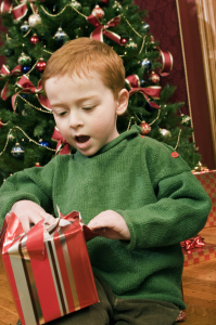 Boy opening a Christmas present