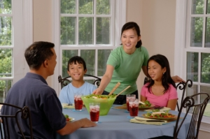 family around the dinner table leads to conversation and increased literacy